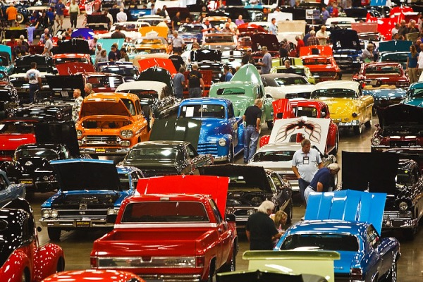 Visitors inspect some of the 600 classic and collector cars on display during the Mecum Auction at the Dallas Convention Center on October 6, 2011 in Dallas. (Patrick T. Fallon/The Dallas Morning News)